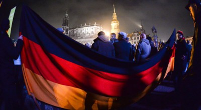 "TOPSHOTS Supporters of the PEGIDA movement, ""Patriotische Europaeer gegen die Islamisierung des Abendlandes,"" which translates to ""Patriotic Europeans Against the Islamisation of the Occident"" gather at a protest rally on October 19, 2015 in Dresden, eastern Germany. AFP PHOTO / DPA /  RALF HIRSCHBERGER     +++ GERMANY OUT +++"