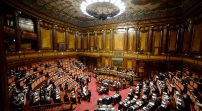 View of the Italian Senate during the debate about same-sex couples civil union, prior to the final vote, in Rome, on February 25, 2016.  Prime Minister Matteo Renzi is bowing to Catholic pressure to remove stepchild adoption rights from the civil unions bill to ease its passage through parliament -- to the fury of gay rights groups. Renzi has called for a vote of confidence on the draft law and without the stepchild clause. / AFP PHOTO / FILIPPO MONTEFORTE