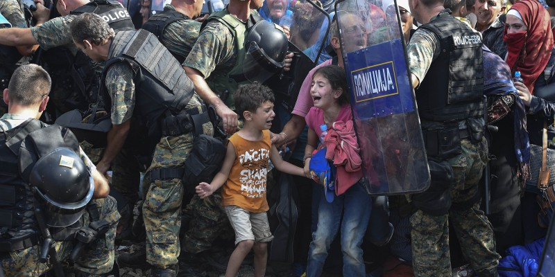Migrants who wait 24 hours on the Greek side of the border line try to breaking through the cordon of Macedonian special police forces to cross in Macedonia near southern city of Gevgelija, The Former Yugoslav Republic of Macedonia, 21 August 2015.Macedonian special police forces arrived yesterday morning and blocked the illegal border crossing between Macedonia and Greece. They don't give permission to the migrants to pass in Macedonia. Macedonian government has declared emergency situation in the south and north border with Greece and Serbia due to rising number of migrants and fugitives from Syria, Afganistan, Iraq, Pakistan and Somalia. From the beginning of the year to mid-June 2015, nearly 160,000 migrants landed in the southern European countries, mainly Greece and Italy, on their way to wealthier countries in Western and Northern Europe, according to estimates by the International Organization for Migration (IOM).