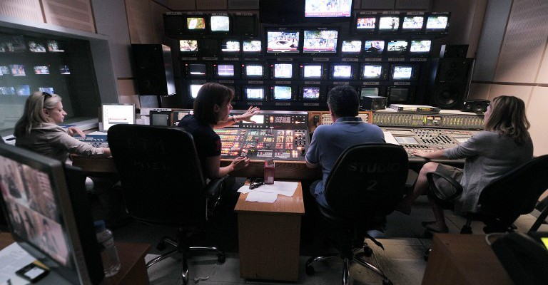 Greece's public TV employees broadcast a Web-Tv signal in a control room at the ERT headquarters in Athens on June 12, 2013, a day after a shock decision by the government to shut down the state broadcaster's operations with immediate effect, a move affecting nearly 2,700 jobs. The announcement comes after months of work stoppages by ERT employees in opposition to plans to restructure the broadcaster as demanded by debt-laden Greece's troika of international creditors. The Greek government said today it will reorganise the state broadcasting company after it abruptly pulled the plug on ERT as part of its austerity drive. AFP PHOTO/ LOUISA GOULIAMAKI