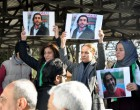 "Women hold pictures of film maker Naji Jerf, who was killed on December 27, during his funeral in Gaziantep on December 28, 2015.  Naji Jerf, a Syrian activist who produced documentaries hostile to the Islamic State group, was assassinated in Turkey on December 27, according to the group with which he worked, ""Raqa is Being Slaughtered Silently"". RBSS is a group of citizen journalists who work to expose human rights abuses in Raqa, the northeastern city that IS uses as its de facto capital in Syria / AFP / STR / Turkey OUT"