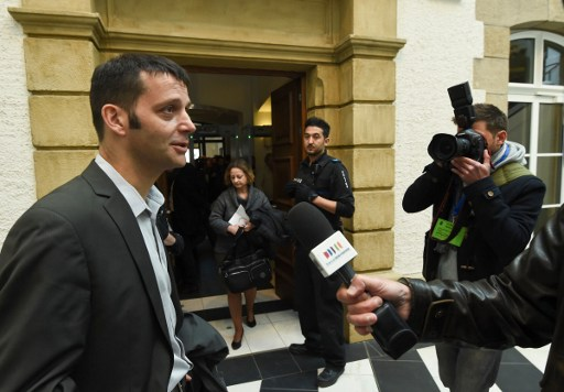 Journalist Edouard Perrin answers journalists' questions as he arrives at the courthouse in Luxembourg on April 26, 2016, for a trial over the so-called LuxLeaks scandal that exposed the country's huge tax breaks for major international companies, with the issue riding high after the recent Panama Papers revelations. Two former employees at services firm PwC, Antoine Deltour and Raphael Halet, and journalist Edouard Perrin face charges over the leaking of thousands of documents that exposed the scandal. The LuxLeaks affair erupted in November 2014, exposing deals that saved firms including Apple, IKEA and Pepsi billions of dollars in taxes while European Commission President Jean-Claude Juncker was Luxembourg's prime minister.  / AFP PHOTO / JOHN THYS