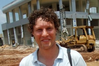 "This picture taken on July 14, 2006 shows Dutch Journalist Jeroen Oerlemans posing for a photograph while on assignment in Beirut.    A Dutch journalist was killed by sniper fire on October 2, 2016 while covering clashes in Libya's coastal city of Sirte, as unity government forces battled Islamic State group holdouts in the jihadist bastion.Dr Akram Gliwan, spokesman for a hospital in Misrata where pro-government fighters are treated, told AFP that photographer Jeroen Oerlemans was ""shot in the chest by an IS sniper while covering battles in Sirte"" 450 kilometres (280 miles) east of Tripoli.  / AFP PHOTO / ANP / HARALD DOORNBOS / Netherlands OUT"