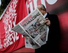 """A man reads a copy of the latest edition of the Turkish daily newspaper """"Cumhuriyet""""  during a demonstration outside the newspaper's headquarters in Istanbul on November 2,2016. Turkish police on November 1, 2016, detained the editor-in-chief of the newspaper Cumhuriyet -- a thorn in the side of President Recep Tayyip Erdogan -- as Ankara widens a crackdown on opposition media. The Cumhuriyet, which had published revelations embarrassing for the government, said at least a dozen journalists and executives were detained in early morning raids. The raids came after authorities fired more than 10,000 civil servants at the weekend and closed 15 pro-Kurdish and other media outlets, the latest purge since July's failed military coup aimed at ousting Erdogan. / AFP PHOTO / YASIN AKGUL"""