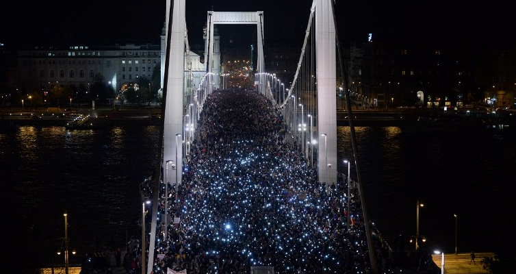 Ten-thousand participants march accross the Elisabeth bridge during an anti-government rally against the goverment's new tax plan for the introduction of the internet tax next year in Budapest on October 28, 2014. AFP PHOTO / ATTILA KISBENEDEK